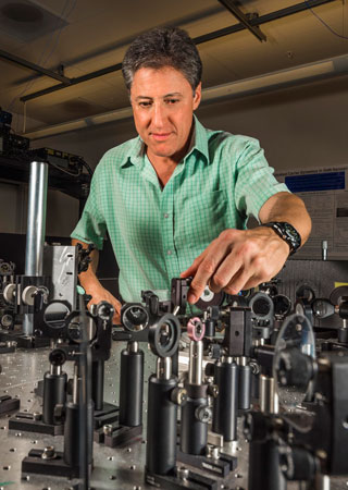 scientists work on optical mixer