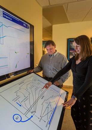 Scientists examine modeling data