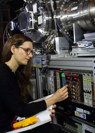 scientist adjusts the Sandia Multiplexed Photoionization Mass Spectrometer