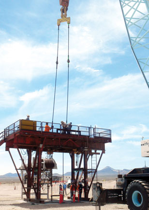 team prepares borehole test on drilling platform
