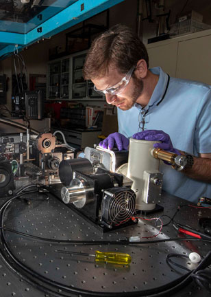 Optical engineer Michael Goldflam in lab