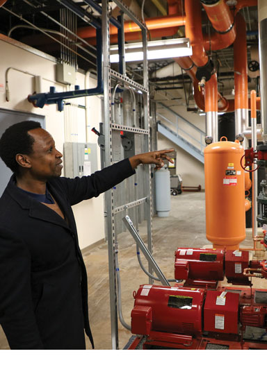 contractors examine hot water pump