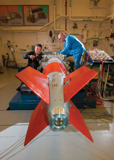 engineers place sensors on B61-12 test unit